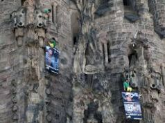 Greenpeace activists scale the Sagrada Familia in protest