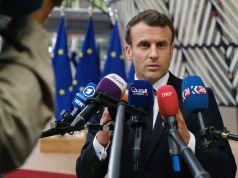 Macron says France past the covid peak